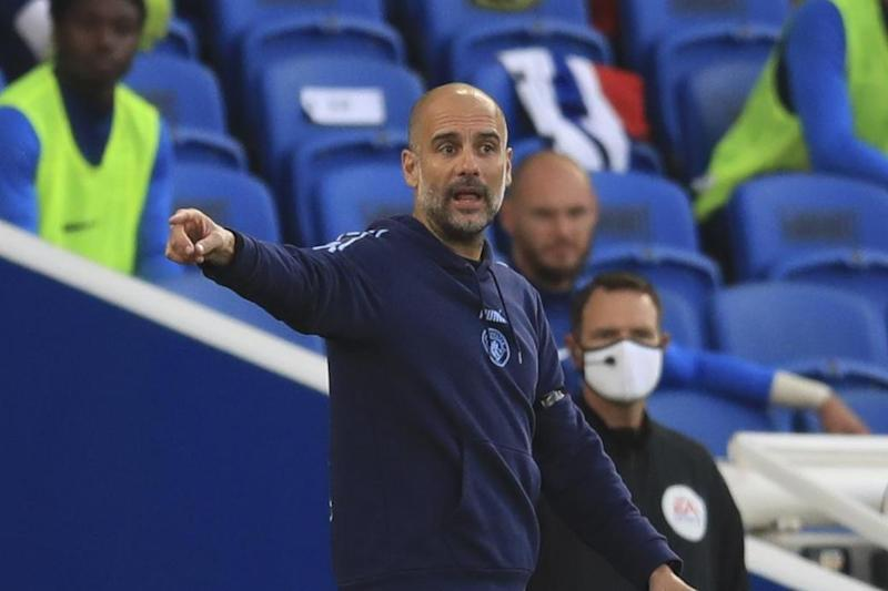 Guardiola watched his side thrash Brighton to seal second place in the Premier League Photo: AP