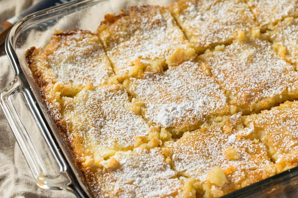 """<p>Gooey is right. This buttery, eggy St. Louis cake was supposedly invented by mistake when a baker mixed up the amounts of butter and flour in a cake recipe. And the result was amazing. Gooey Butter Cake is one of <a href=""""https://www.thedailymeal.com/eat/must-try-food-all-50-states-gallery?referrer=yahoo&category=beauty_food&include_utm=1&utm_medium=referral&utm_source=yahoo&utm_campaign=feed"""" rel=""""nofollow noopener"""" target=""""_blank"""" data-ylk=""""slk:the must-try foods in America"""" class=""""link rapid-noclick-resp"""">the must-try foods in America</a>.</p> <p><a href=""""https://www.thedailymeal.com/recipes/gooey-butter-cake?referrer=yahoo&category=beauty_food&include_utm=1&utm_medium=referral&utm_source=yahoo&utm_campaign=feed"""" rel=""""nofollow noopener"""" target=""""_blank"""" data-ylk=""""slk:For the Gooey Butter Cake recipe, click here."""" class=""""link rapid-noclick-resp"""">For the Gooey Butter Cake recipe, click here.</a></p>"""