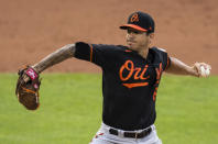 Baltimore Orioles starting pitcher Tommy Milone throws during the first inning of a baseball game against the Washington Nationals in Washington, Friday, Aug. 7, 2020. (AP Photo/Manuel Balce Ceneta)