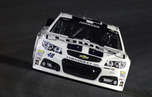 Jimmie Johnson drives through Turn 4 during the NASCAR Sprint Cup Series auto race at Charlotte Motor Speedway in Concord, N.C., Saturday, Oct. 12, 2013. (AP Photo/Gerry Broome)