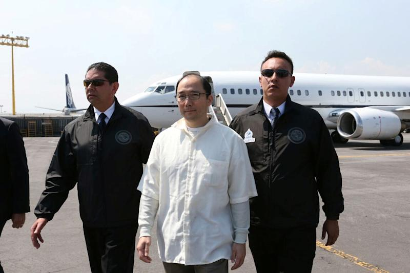 Zhenli Ye Gon, a businessman accused of working with drug cartels, is escorted by Interpol agents after arriving from the United States on a extradition flight in a hangar belonging to the office of the Attorney General in Mexico City, Mexico, October 18, 2016. REUTERS/PGR - Attorney General's Office/Handout via Reuters ATTENTION EDITORS - THIS IMAGE WAS PROVIDED BY A THIRD PARTY. EDITORIAL USE ONLY.