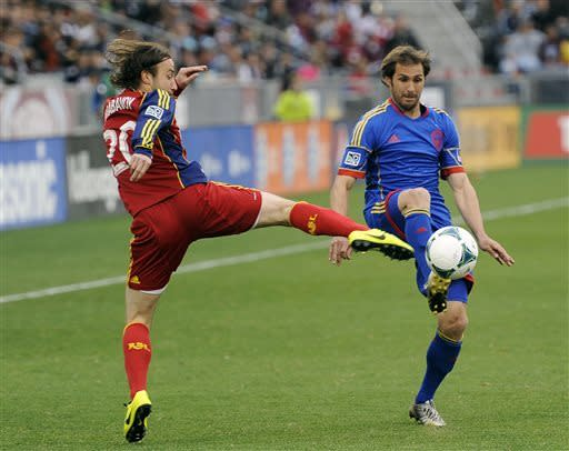 Real Salt Lake midfielder Ned Grabavoy, left, and Colorado Rapids midfielder Brian Mullan, right, fight for possession in the first half of an MLS soccer game in Commerce City, Colo., on Saturday, April 6, 2013. (AP Photo/Chris Schneider)