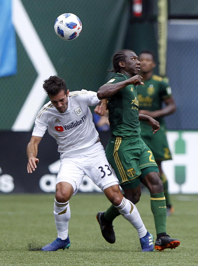 Portland Timbers' Doego Chara (21) battles LAFC's Benny Feilhaber (33) for possession during an MLS soccer game, Saturday, May 19, 2018, in in Portland, Ore. (Sean Meagher//The Oregonian via AP)