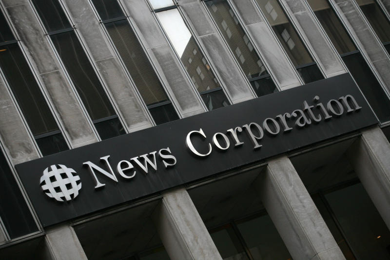 FILE- This Monday, Feb. 1, 2010, file photo, shows News Corp.'s headquarters in New York. Rupert Murdoch's News Corp. said Thursday, June 28, 2012, that it plans to split into two separate companies, one holding its newspaper business and the other its entertainment operations. (AP Photo/Mark Lennihan, File)