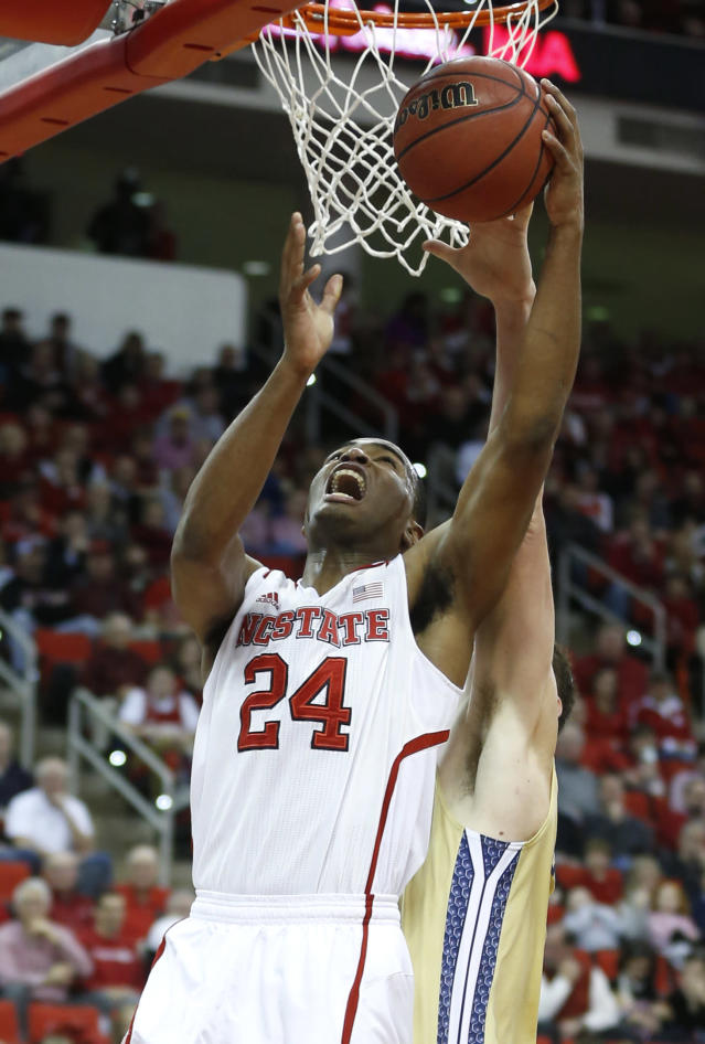 North Carolina State's T.J. Warren (24) shoots against Georgia Tech during the first half of an NCAA college basketball game at PNC Arena, Sunday, Jan. 26, 2014, in Raleigh, N.C. (AP Photo/The News & Observer, Ethan Hyman)