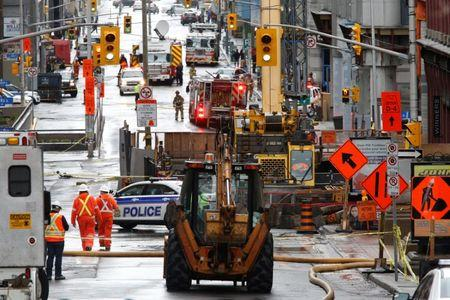 Emergency personnel and workers are pictured at the scene of a gas leak in downtown Ottawa