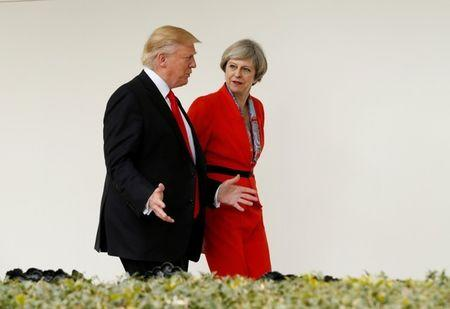 FILE PHOTO: U.S. President Donald Trump escorts British Prime Minister Theresa May down the White House colonnade after their meeting at the White House in Washington, U.S., January 27, 2017. REUTERS/Kevin Lamarque/File Photo