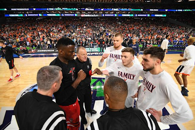 Jack Salt #33 of the Virginia Cavaliers greets Norense Odiase #32 of the Texas Tech Red Raiders at mid court before the start of the game between the Virginia Cavaliers and the Texas Tech Red Raiders during the 2019 NCAA Men's Final Four National Championship game at U.S. Bank Stadium on April 08, 2019 in Minneapolis, Minnesota. (Photo by Jamie Schwaberow/NCAA Photos via Getty Images)