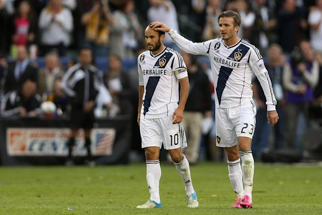 CARSON, CA - DECEMBER 01: Landon Donovan #10 and David Beckham #23 of Los Angeles Galaxy celebrate in the second half agaisnt the Houston Dynamo in the 2012 MLS Cup at The Home Depot Center on December 1, 2012 in Carson, California. (Photo by Jeff Gross/Getty Images)