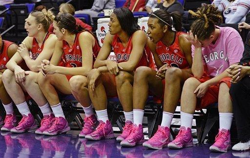 From left, Georgia's Merritt Hempe, Anne Marie Armstrong, Tamika Willis, Kaelyn Causwell and Danielle Bennett watch from the bench in the closing minutes of the second half of an NCAA college basketball game against LSU in Baton Rouge, La., Sunday, Feb. 10, 2013. LSU won 62-54. (AP Photo/Bill Feig)