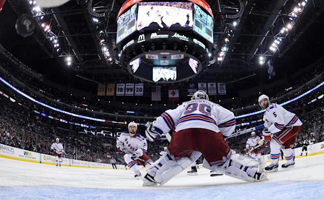 New York Rangers goalie Henrik Lundqvist, center, of Sweden, is scored on by Los Angeles Kings right wing Justin Williams to win Game 1 of the NHL hockey Stanley Cup Finals as right wing Mats Zuccarello, left, of Norway, and defenseman Dan Girardi watch, Wednesday, June 4, 2014, in Los Angeles. (AP Photo/Bruce Bennett, Pool)