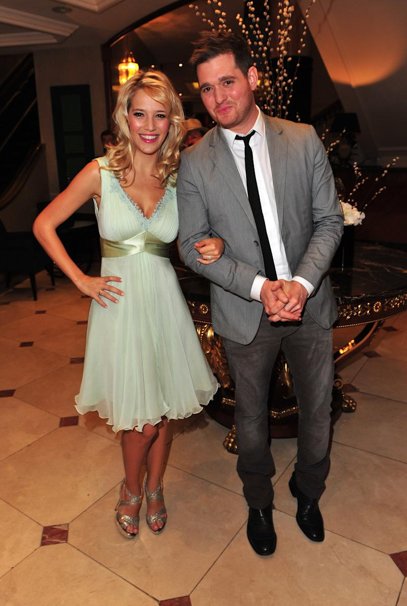 "FILE - In this June 29, 2012 file photo, Argentine TV actress Luisana Lopilato, left, and husband singer Michael Buble arrive at the Nordoff Robbins 02 Silver Clef Awards at London Hilton, in London. Buble has sold millions of albums, but as he readies the release of his newest project, he's less concerned with his future album sales, thanks to his wife's pregnancy. ""I'm nervous and excited, and truly I think it's given me great perspective,"" the singer said at the music video shoot for his new single, ""It's a Beautiful Day."" (Photo by Jon Furniss/Invision/AP, File)"