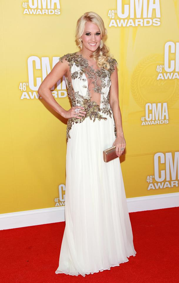 "<p class=""MsoNormal"">Carrie Underwood<span style=""color:black;""> </span><span style=""color:black;""><span style=""color:black;"">– </span>who served as the evening's co-host along with Brad Paisley – donned a plunging dress adorned with strategically place floral appliqués that allowed her to show a little skin. A sideswept pony, dramatic eye makeup, and bright smile topped off her lovely ensemble. (11/1/2012)</span></p>"