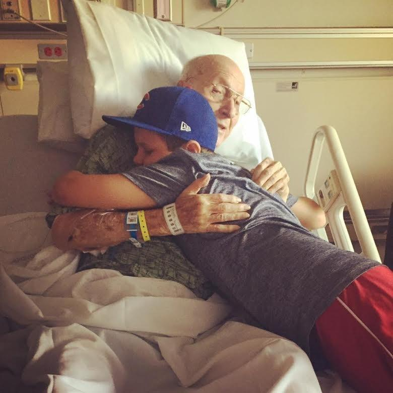 Chase and his great grandfather share a hug.  (Lindsay Marcy)