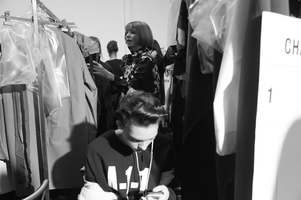 <p>Anna Wintour gets a preview of Marni's new collection while model Charlee Fraser waits for hair and makeup.</p>