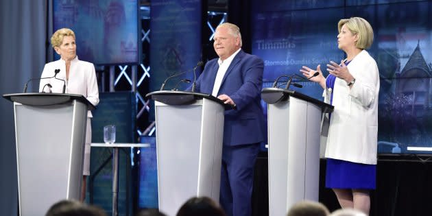 Ontario NDP Leader Andrea Horwath, right, speaks as Ontario Liberal Leader Kathleen Wynne, left, and Ontario Progressive Conservative Leader Doug Ford look on during the third and final televised debate of the provincial election campaign in Toronto on May 27, 2018.