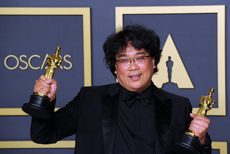 HOLLYWOOD, CA - FEBRUARY 09: Bong Joon Ho poses with his Award for Best Director, Best Picture ('Parasite') inside The Press Room of the 92nd Annual Academy Awards held at Hollywood and Highland on February 9, 2020 in Hollywood, California. (Photo by Albert L. Ortega/Getty Images)