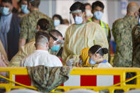 One of the evacuees from Afghanistan undergoes a COVID test after disembarking from a U.S. airforce plane at the Naval Station in Rota, southern Spain, Tuesday Aug. 31, 2021. The United States completed its withdrawal from Afghanistan late Monday, ending America's longest war. (AP Photo/ Marcos Moreno)