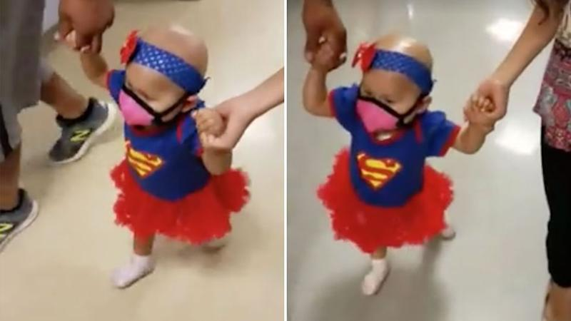 The touching moment a one-year-old girl walks out of hospital after her last chemotherapy treatment. Photo: Roxana Meza/Facebook