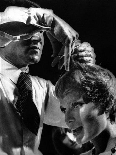 British hairdresser Vidal Sassoon cutting the hair of actress Mia Farrow for her new film on August 15, 1967 in Hollywood, Los Angeles, California. The studio flew Sassoon and his wife from London to Hollywood for the haircut. The expenses are expected to run to 5,000 dollars. (AP Photo)