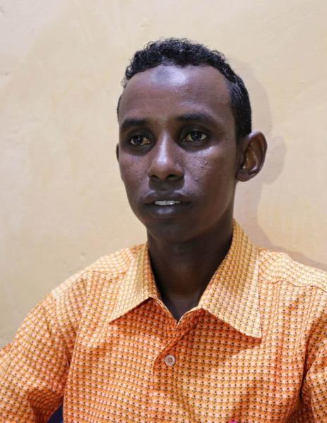 Mohamed Omar Abukar, a Somali student, talks during an interview with Reuters after his mother and nieces were injured during an airstrike in Mogadishu