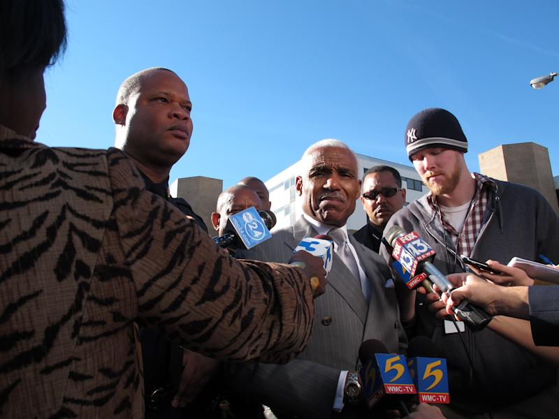 Memphis Police Department Director Toney Armstrong, left, and Memphis Mayor A C Wharton Jr., center,  speak with reporters outside the Regional Medical Center after two police officers were involved in a shooting on Friday, Dec. 14, 2012 in Memphis, Tenn. One officer was killed and another officer was wounded. The wounded officer was being treated at the medical center. (AP Photo/Adrian Sainz)