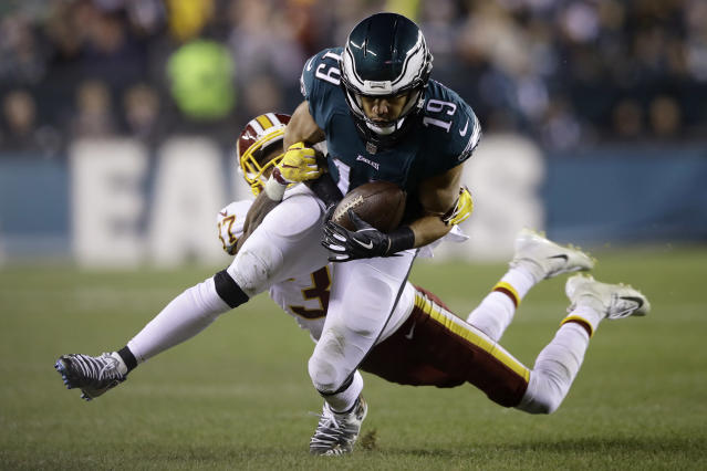 Philadelphia Eagles' Golden Tate (19) is tackled after a catch by Washington Redskins' Greg Stroman (37) during the second half of an NFL football game, Monday, Dec. 3, 2018, in Philadelphia. (AP Photo/Matt Rourke)