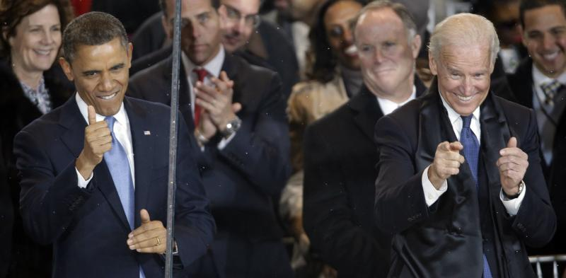 President Barack Obama and Vice President Joe Biden react during the inaugural parade on Pennsylvania Avenue near the White House, Monday, Jan. 21, 2013, in Washington. Thousands marched during the 57th Presidential Inauguration parade after the ceremonial swearing-in of President Barack Obama. (AP Photo/Gerald Herbert)
