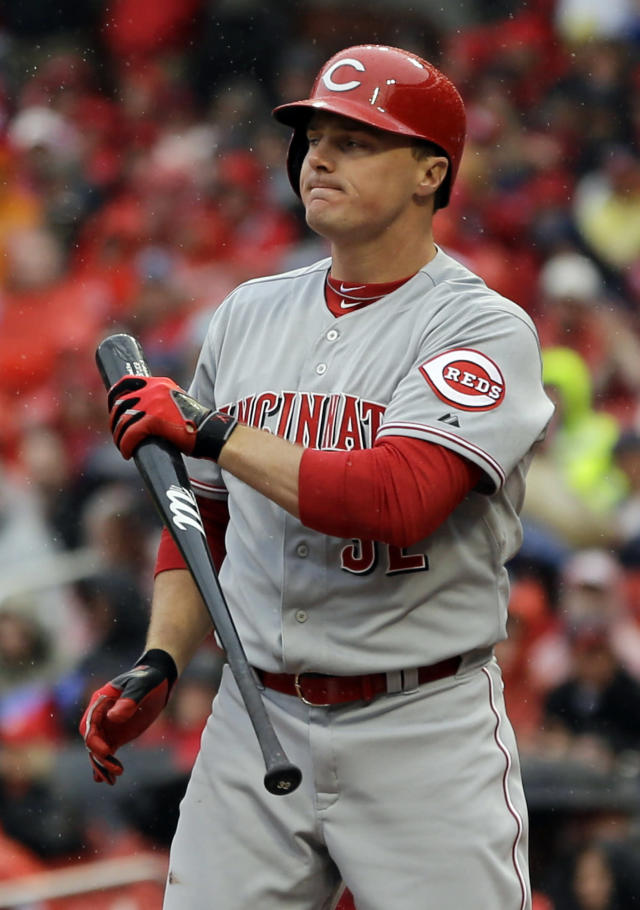 Cincinnati Reds' Jay Bruce holds his bat after striking out to end the top of the first inning of a baseball game against the St. Louis Cardinals, Monday, April 7, 2014, in St. Louis. (AP Photo/Jeff Roberson)