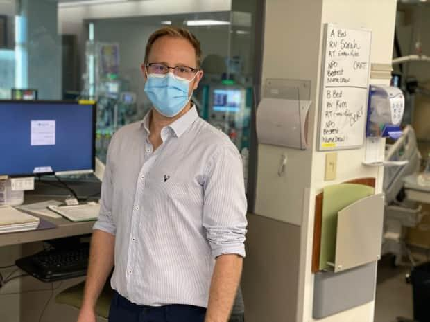 Intensive care specialist Dr. Adam Hall said staff at Red Deer Regional Hospital are working to the point of exhaustion to care for an ever-growing number of very sick and dying COVID-19 patients. ( Dr. Adam Hall - image credit)