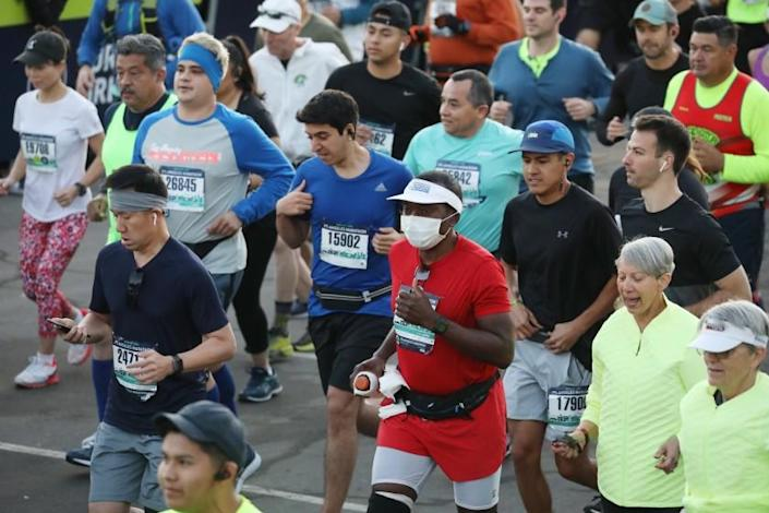 LOS ANGELES CA MARCH8, 2020 -- A handful of runners chose to wear protective mask wile participation in the 35th annual L.A. Marathon at Dodger Stadium on Sunday, March 8, 2020 in Los Angeles, California. (Patrick T. Fallon/ For The Los Angeles Times)