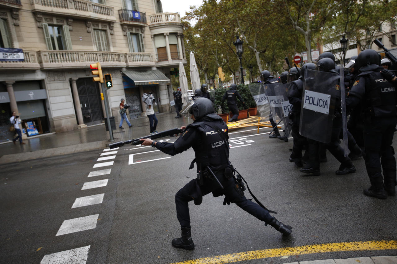 <p>Spanish riot police shoots rubber bullet straight to people trying to reach a voting site at a school assigned to be a polling station by the Catalan government in Barcelona, Spain, Oct. 1, 2017. (Photo: Emilio Morenatti/AP) </p>