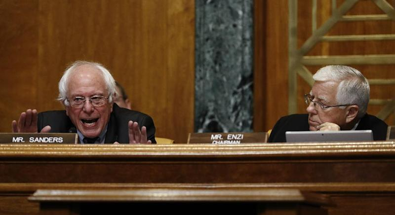 Senate Budget Committee Chairman Sen. Mike Enzi, R-Wyo. listens at right as the committee's ranking Member, Sen. Bernie Sanders, I-Vt., speaks during on Capitol Hill in Washington, Tuesday, Jan. 24, 2017, during the committee's confirmation hearing for Budget Director-designate Rep. Mick Mulvaney's, R-S.C. (AP Photo/Carolyn Kaster)