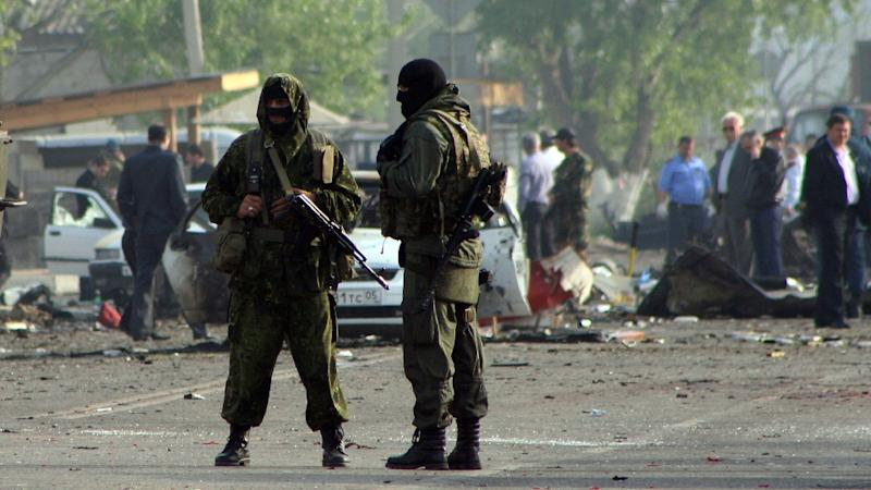 Special forces officers guard the site of two blasts in Dagestan's capital Makhachkala, part of Russia's restive Caucasus region, on May 4, 2012 (AFP Photo/Abdula Magomedov)