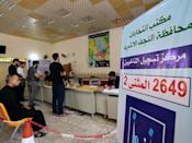 Iraqis in Najaf register for voting cards ahead of parliamentary elections (AFP/Ali NAJAFI)