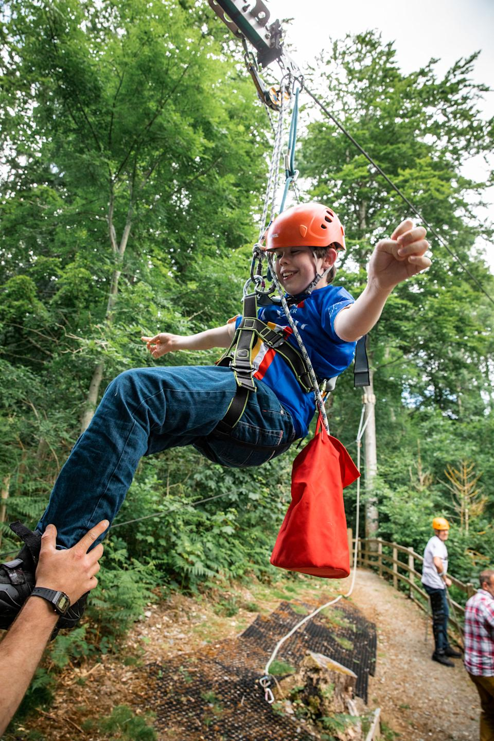 Celebrating completing the zip wire and raising £250,000 (Supplied)