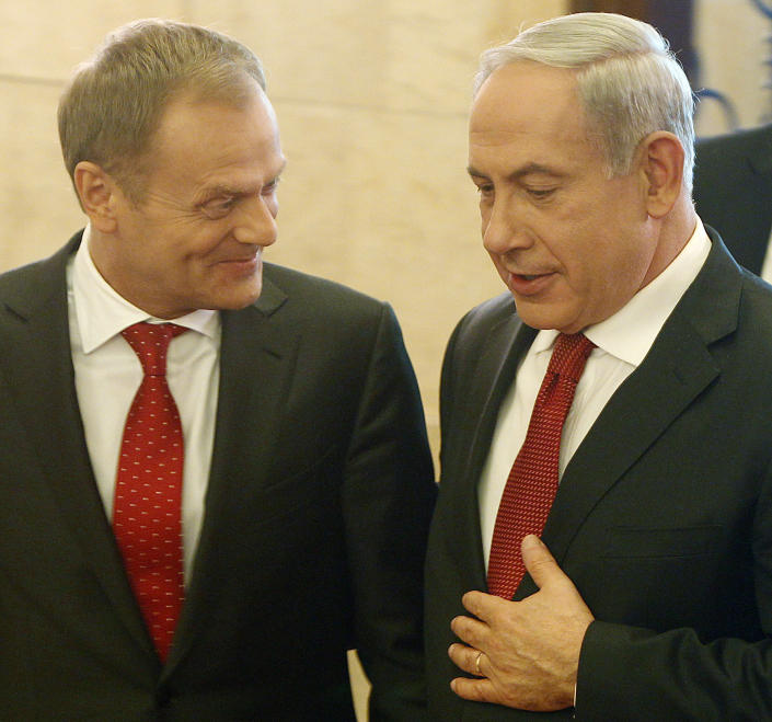 Israeli Prime Minister Benjamin Netanyahu,right, and his Polish counterpart Donald Tusk share a word during a welcome ceremony in Warsaw, Poland, Wednesday, June 12, 2013. Netanyahu came to Poland for a two day visit for talks with Tusk and to attend the opening of a Holocaust exhibition in the former German Nazi Death Camp Auschwitz Birkenau. (AP Photo/Czarek Sokolowski)