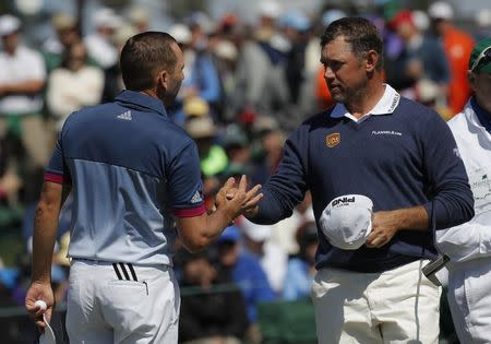 Sergio Garcia of Spain (L) shakes hands with Lee Westwood of England after they finished their second round play on the 18th green during the 2017 Masters golf tournament at Augusta National Golf Club in Augusta, Georgia, U.S., April 7, 2017. REUTERS/Brian Snyder