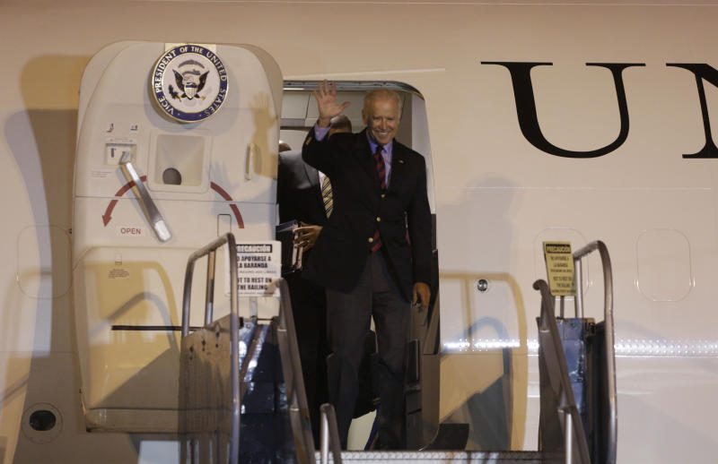 U.S. Vice President Joe Biden waves upon his arrival at the Tocumen International Airport in Panama City, Monday, Nov. 18, 2013. Biden arrived in Panama for a two-day official visit. (AP Photo/Arnulfo Franco)