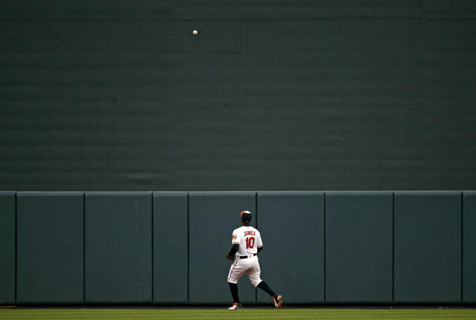 Baltimore Orioles center fielder Adam Jones watches a a solo home run Seattle Mariners' Ryon Healy during the second inning of a baseball game Wednesday, June 27, 2018, in Baltimore. (AP Photo/Patrick Semansky)