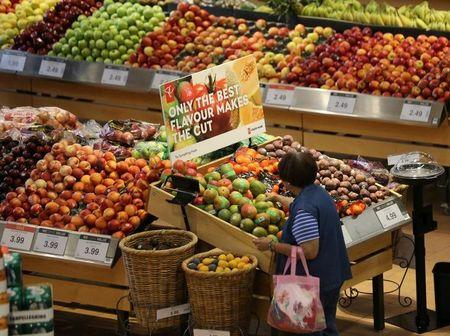 A woman browses in the fruit section of a Loblaw supermarket in Collingwood