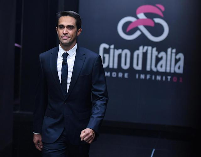 """Retired cyclist Alberto Contador attends the presentation of the """"Giro d'Italia"""", Tour of Italy, 2018 in Milan, Italy, Wednesday, Nov. 29, 2017. Four-time Tour de France champion Chris Froome says he will ride the Giro d'Italia next year in an attempt to win a third consecutive Grand Tour. (Daniel Dal Zennaro/ANSA via AP)"""