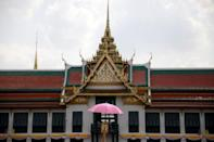 People wait outside the balcony of Suddhaisavarya Prasad Hall at the Grand Palace, where King Maha Vajiralongkorn will grant a public audience to receive the good wishes of the people in Bangkok, Thailand May 6, 2019. REUTERS/Navesh Chitrakar