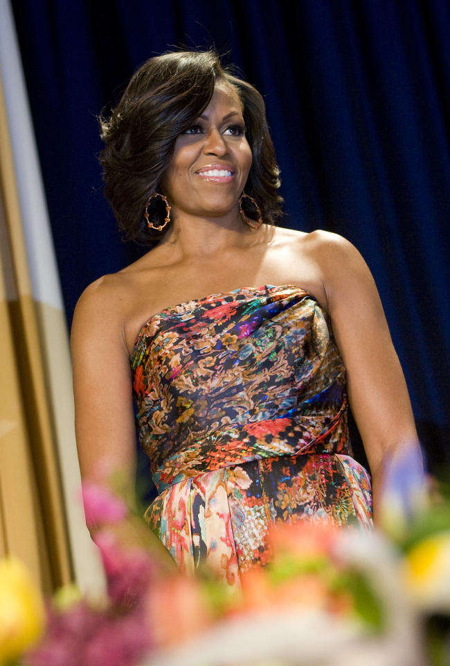 First lady Michelle Obama arrives to the 2012 White House Correspondents' Association Dinner held at the Washington Hilton on April 28, 2012 in Washington, DC. (Photo by Kristoffer Tripplaar-Pool/Getty Images)