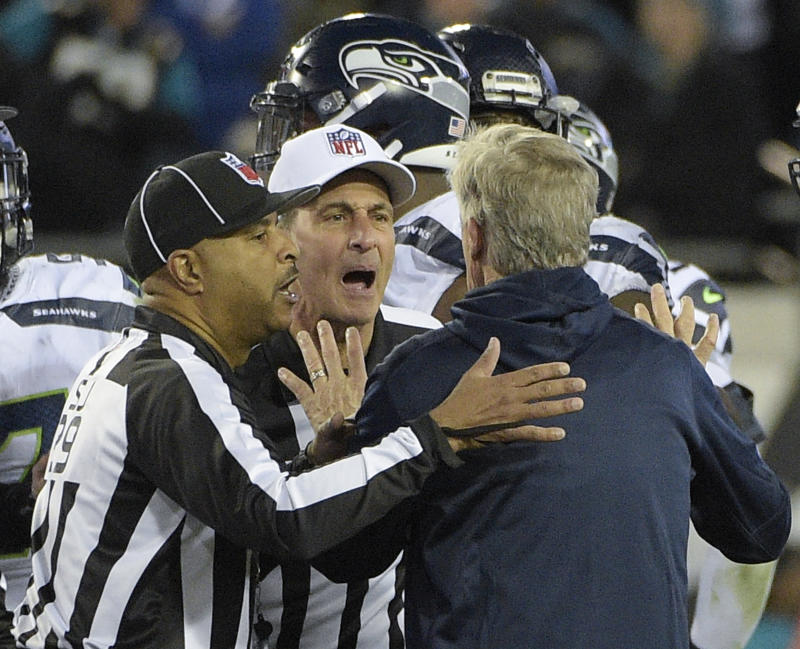 Seattle Seahawks head coach Pete Carroll is held back by officials at the end of last week's game against the Jaguars. (AP)