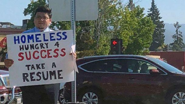 PHOTO: David Casarez handed out resumes on a street corner in Mountain View, California looking for a job opportunity. (Jasmine Scofield )