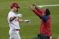 St. Louis Cardinals' Jack Flaherty, left, gets a hug from teammate Carlos Martinez after hitting a solo home run during the third inning of a baseball game against the Colorado Rockies Friday, May 7, 2021, in St. Louis. (AP Photo/Jeff Roberson)