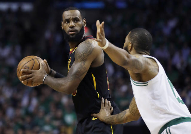Cleveland Cavaliers forward LeBron James keeps the ball from Boston Celtics forward Marcus Morris during the first quarter of Game 5 of the NBA basketball Eastern Conference finals Wednesday, May 23, 2018, in Boston. (AP Photo/Charles Krupa)