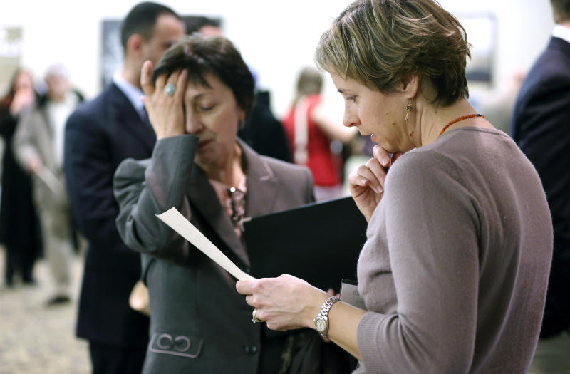 In this Monday, Feb. 25, 2013 photo, Ann Oganesian, left, of Newton, Mass., pauses as she speaks with a State Department employee about job opportunities with the federal government during a job fair in Boston. U.S. employers ramped up hiring in February, adding 236,000 jobs and pushing the unemployment rate down to 7.7 percent from 7.9 percent in January. Stronger hiring shows businesses are confident about the economy, despite higher taxes and government spending cuts. (AP Photo/Michael Dwyer)