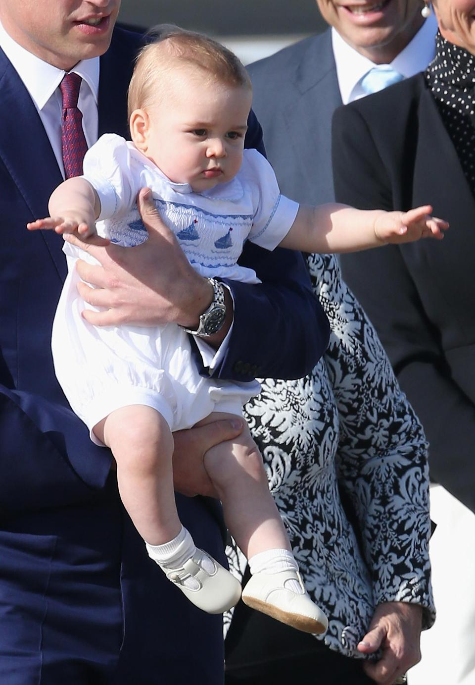 <p>Back in April 2014, the Duke and Duchess of Cambridge took George on his debut royal tour. And the prince certainly dressed the part, as he donned his favourite romper. <em>[Photo: Getty]</em> </p>